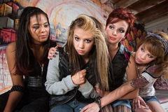 Girls Comfort Friend. Group of cute teenage girls comforting their friend Royalty Free Stock Image