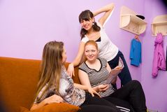 Girls in the common room fitness center Stock Photos