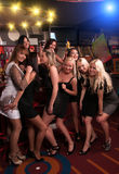 Girls company having fun in the night club Royalty Free Stock Image
