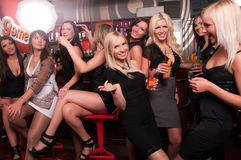 Girls company having fun in the night club. Group of Girls company having fun in the night club Royalty Free Stock Images