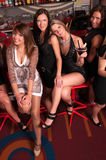 Girls company having fun in the night club Stock Photography