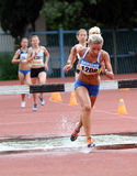 Girls compete in the 3.000 Meter Steeplechase Stock Photo