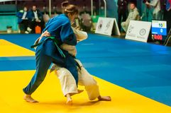 Girls compete in Judo. Orenburg, Southern Ural, Russia - 29. 10. 2014: The Girls compete in the All-Russian Judo tournament in memory of Viktor Chernomyrdin royalty free stock photography