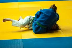 Girls compete in Judo. Orenburg, Southern Ural, Russia - 29.10.2014: The Girls compete in the All-Russian Judo tournament in memory of Viktor Chernomyrdin stock photography