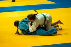 Girls compete in Judo. Orenburg, Southern Ural, Russia - 29.10.2014: The Girls compete in the All-Russian Judo tournament in memory of Viktor Chernomyrdin stock images