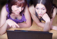 Girls with computer Stock Images
