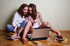 Girls with a computer Royalty Free Stock Image
