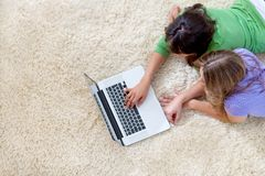 Girls on the computer Royalty Free Stock Photography