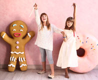 Girls in confectionery designed room Stock Photos