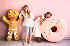 Girls in confectionery designed room Royalty Free Stock Image
