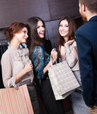 Girls consult with salesperson Royalty Free Stock Photos