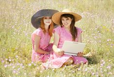 Girls at contryside with notebook. Stock Photography