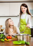 Girls cooking  together Royalty Free Stock Image