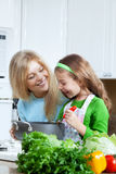 Girls are cooking Stock Images