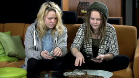 Girls coounting the bank notes alternately stock footage