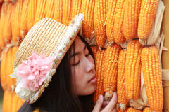 Girls and corn. Royalty Free Stock Images