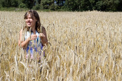 Girls in a cornfield Royalty Free Stock Photography