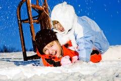 Girls crashing at sledding Royalty Free Stock Images