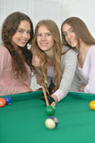 Girls with cue playing billiard Stock Image