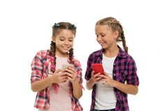 Girls cute small children smiling to phone screen. They like internet surfing social networks. Problem of young stock image