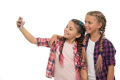 Girls cute small children smiling to phone screen. They like taking selfie for social networks. Problem of young royalty free stock photo