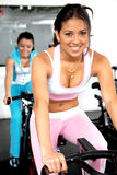 Girls cycling at the gym Royalty Free Stock Photo