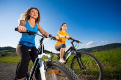 Girls cycling Stock Images