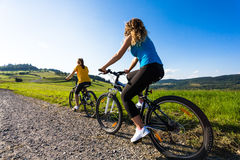 Girls cycling Royalty Free Stock Image