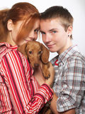 Girls with a dachshund Royalty Free Stock Images