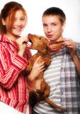 Girls with a dachshund Stock Images