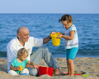 Girls with dad at sea Royalty Free Stock Photography