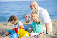 Girls with dad  on  sea shore Royalty Free Stock Images