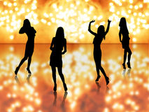 Girls dancing. Silhouettes in night lights Stock Photography