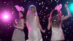 Girls dancing at bachelorette party against stroboscope lamps. Slow motion. Girls dancing at bachelorette party against stroboscope lamps, glitter confetti stock video footage