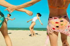 Girls dancing at the beach Royalty Free Stock Photo