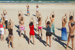 Girls dancing at the beach. Group of active girls dancing at the beach Royalty Free Stock Photos
