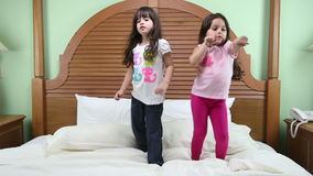 Girls dancing in the bed stock video footage