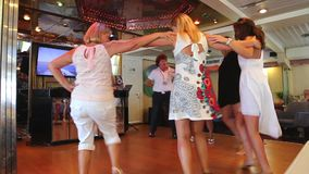 Girls dancing and enjoy in cruise trip - Greece stock video footage