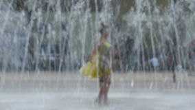 Girls dancing at the fountain. Two girls dancing in the fountain, images is blurred, no recognizable people stock video
