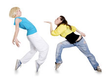 Girls dancing hip-hop over white background Royalty Free Stock Image