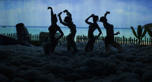 Girls dancing at a party. In the foam Royalty Free Stock Photos