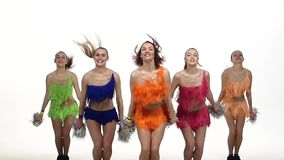 Girls dancing with pom-poms  synchronously in stock video footage