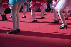 Girls dancing on a show outdoors Royalty Free Stock Photo