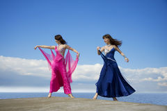 Girls dancing on the sky Royalty Free Stock Photo