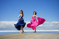 Girls dancing on the sky Stock Photos