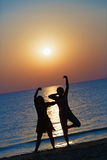 Girls dancing at sunset Royalty Free Stock Images