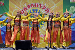 Girls dancing in traditional dressing at Sabantuy. Sabantuy - national holiday celebrated in the present time many nations of the Volga and Southern Urals of royalty free stock photo