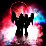 Girls in the dark tunnel Stock Image