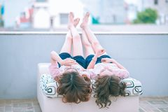 Girls on day bed outdoors Royalty Free Stock Photography