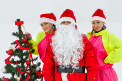 Girls decking up the Christmas tree Royalty Free Stock Photos